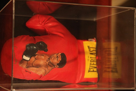 Signed Cassicus Clay and in Mint Condition Muhammad Ali Boxing Glove with Illustration signed by Muhammad Ali