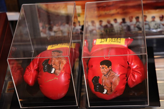 Signed and in Mint Condition Muhammad Ali Boxing Glove Set with painted on Illustration