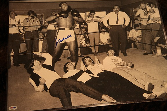 A 16x20 rare copy of Muhammad Ali with The Beattles signed by the Champ it includes a letter of Authenticity