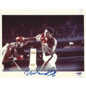 Signed 8x10 copy of Muhammad Ali and his famous Right Hook