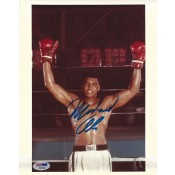 Signed 8x10 of Muhammad Ali raising his gloves after another victory